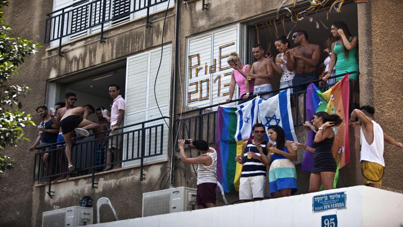 People take part at the annual Gay Pride parade from balconies in Tel Aviv